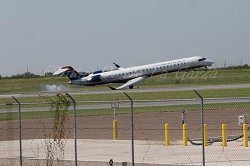 2015-09-29_Mesa_CRJ7_@McAllen_mesa air hard landing_ACC1