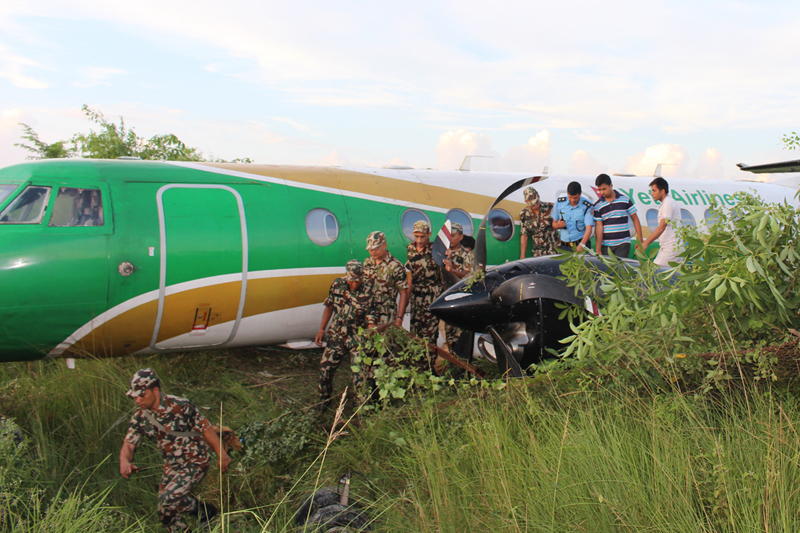 Security personnel take stock of the situation after a Yeti Airlines aircraft overshoots the runway of Bhairahawa Airport in Rupandehi, on Saturday, September 24, 2016. Photo: RSS